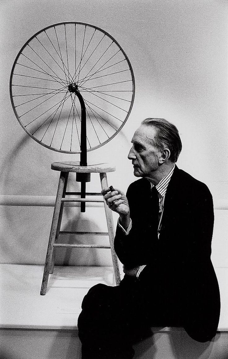 Marcel Duchamp with his bicycle wheel, 1963. Julian Wasser. Silver Gelatin Print