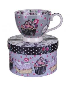 Ditsy Teacup  Drink you brew from this beautiful teacup.The outside of the cup is beautifully decorated with cakes and flowers
