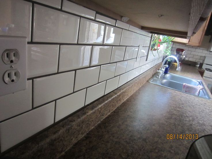 White Subway Tile Backsplash with dark grout