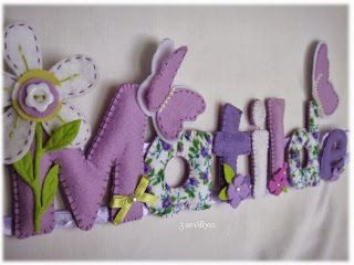 Placa de nome em feltro - Matilde, com borboletas. {Name banner for girl with flowers and butterflies - in purple and blue. }