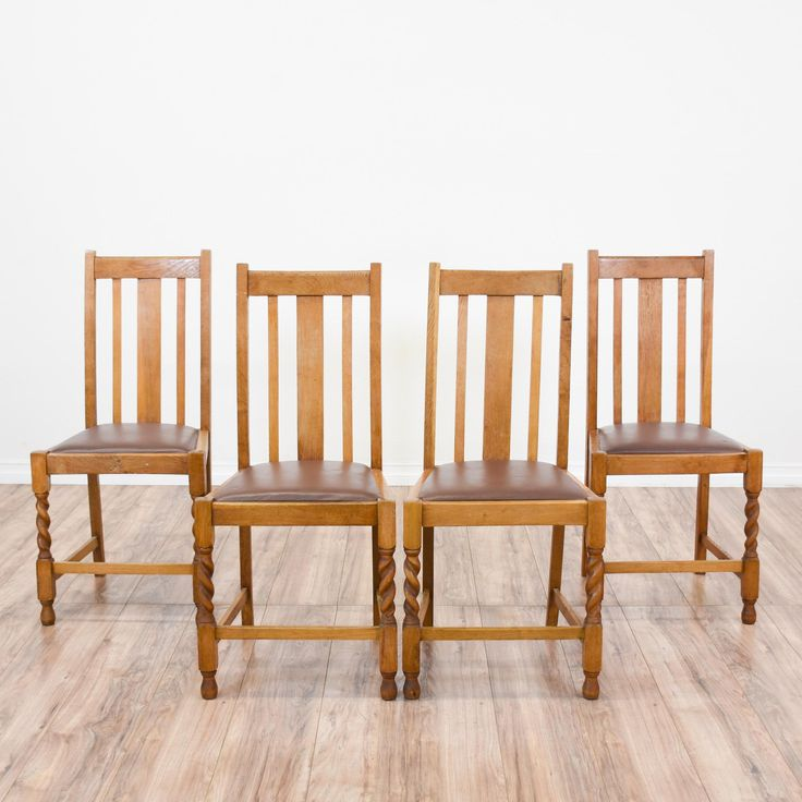 This set of 4 mission style dining chairs are featured in a solid wood with a rustic light oak finish. These craftsman chairs are in great condition with tall backs, brown leather upholstered seat cushions and carved twist details. Perfect for formal and casual dining! #mission #chairs #chair #sandiegovintage #vintagefurniture