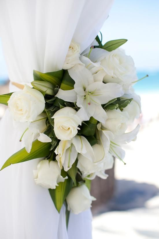 Simple white flowers to decorate a wedding gazebo