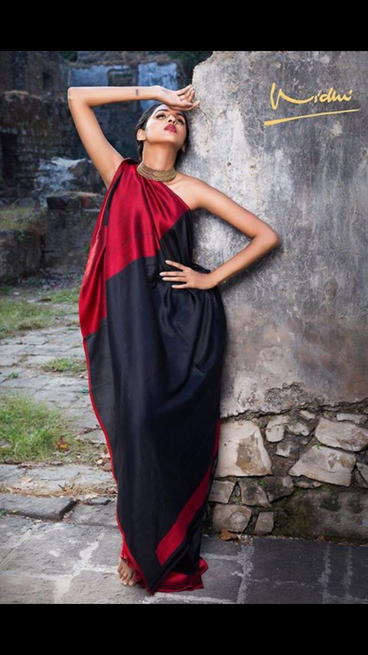 Simplicity at its best. Black and Red woven saree by Vidhi Singhania