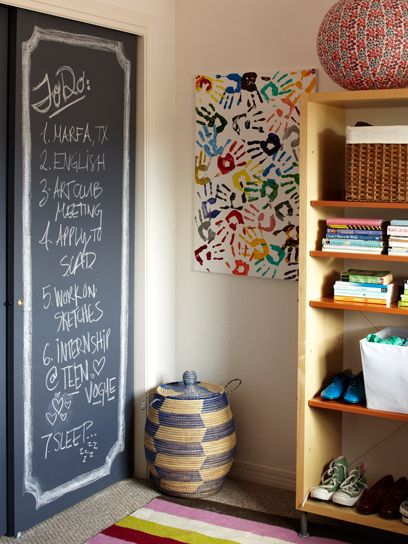I like the chalkboard paint (which i've done before) but what's catching my eye here is the hand print canvas...what a great way to save their tiny hands forever all in one place..