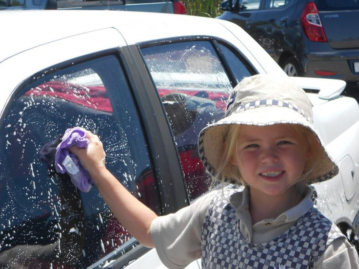 """The Junior Primary """"Outdoor Club"""" at Elkanah House enjoyed an outdoor activity with a difference by washing their parents' cars as a fun activity in the campus parking area."""