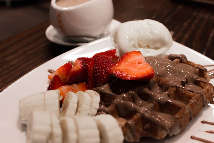 Max Brenner's Belgian waffles are studded with little sugar crystals and topped with freshly cut fruit and a small blob of vanilla ice cream. @Melbourne Central.  Off The Eaten Track: 10 Must Try Foods In Melbourne | Trip101