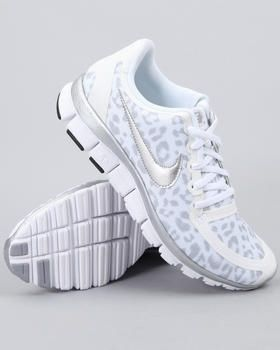 White leopard print Nike running shoes