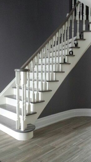 Grey Staircase. Red oak stained grey. White spindles grey stair treds. #greystairs #staircase #grey