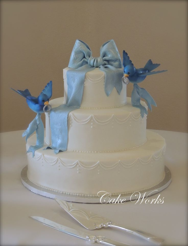 Well this is just darling!  a Fairytale Bluebird Wedding cake for a Cinderella themed fairtale wedding