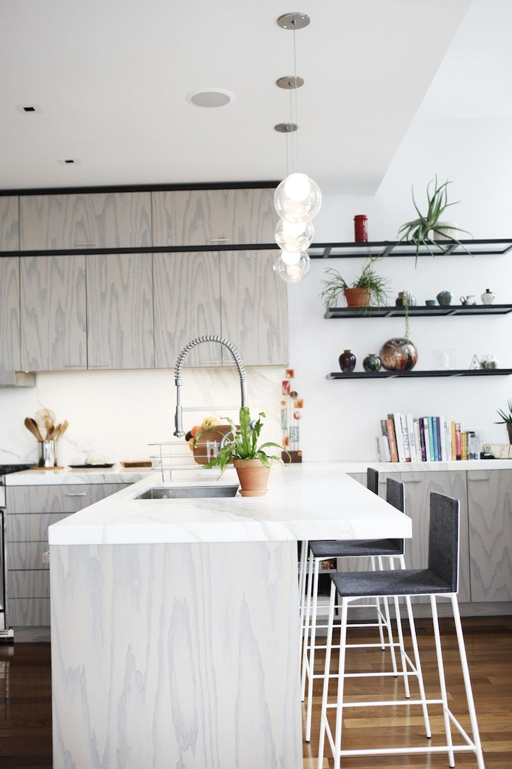 marble counter // wood cabinets // modern black bar stools