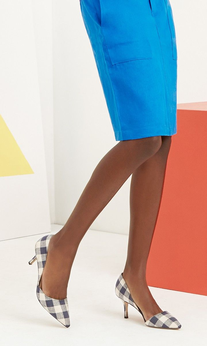 Navy plaid d'Orsay mid heel with a pointed toe and an ultra-walkable heel. The epitome of office-to-out style.
