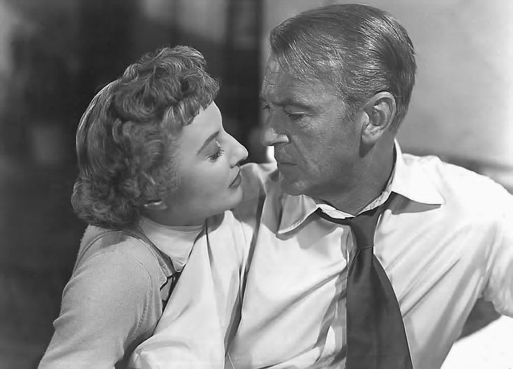 BLOWING WILD (1953) - Married woman (Barbara Stanwyck) makes a romantic play for her wealthy husband's best friend (Gary Cooper) - Directed by Hugo Fregonese - Warner Bros. - Movie Still.