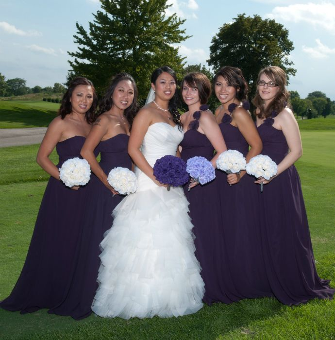 This bride chose the Purple Silk Rose Hand Tie with 3 dozen rose for her bouquet. Her maid of honor has the Lavender Silk Rose Hand Tie with 2 dozen roses and her bridesmaids are carrying the Ivory Silk Rose Hand Tie with 2 dozen roses. The bride's bouquet can be found here:  http://www.thebridesbouquet.com/purple-silk-rose-hand-tie-3-dozen-roses-bridal-wedding-bouquet/