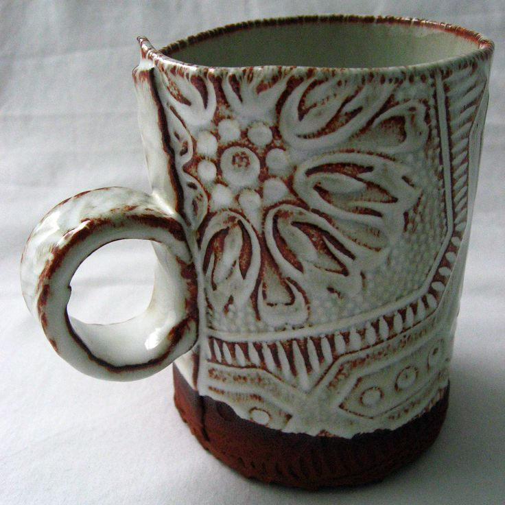 rootstock studio nice design for hand built mugwhite glaze over dark clay and rubbed off - Pottery Design Ideas
