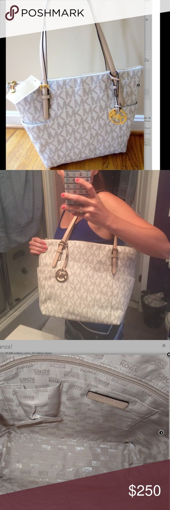 Michael kors jetset vanilla large tote nwt Brand new white jetset tote. Has straps and gold hardware and zippers shut. Inside compartments as well. Very roomy and can hold a lot! No trades please. New with tags Michael Kors Bags Shoulder Bags