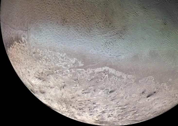 Triton (moon of Neptune)  Triton is Neptune's largest moon. It's so far from the sun (and therefore, soooo cold) that all the nitrogen in its atmosphere has settled on the surface as frost