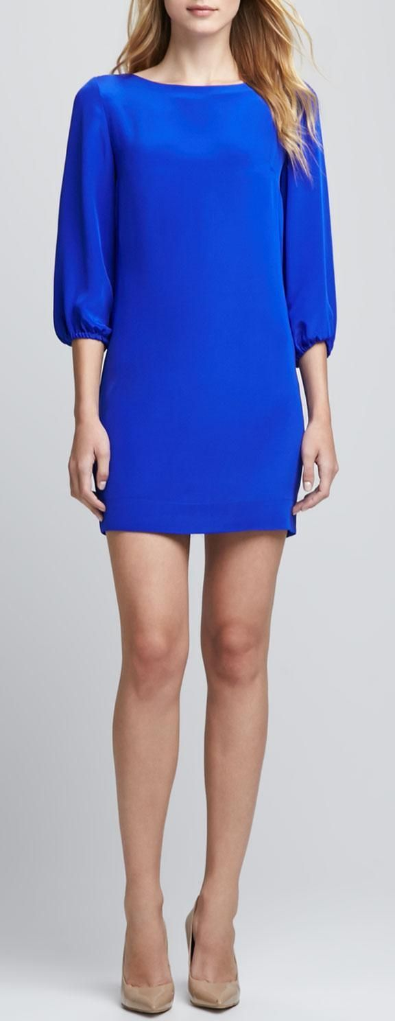 Simple blue dress with skin tone shoes.