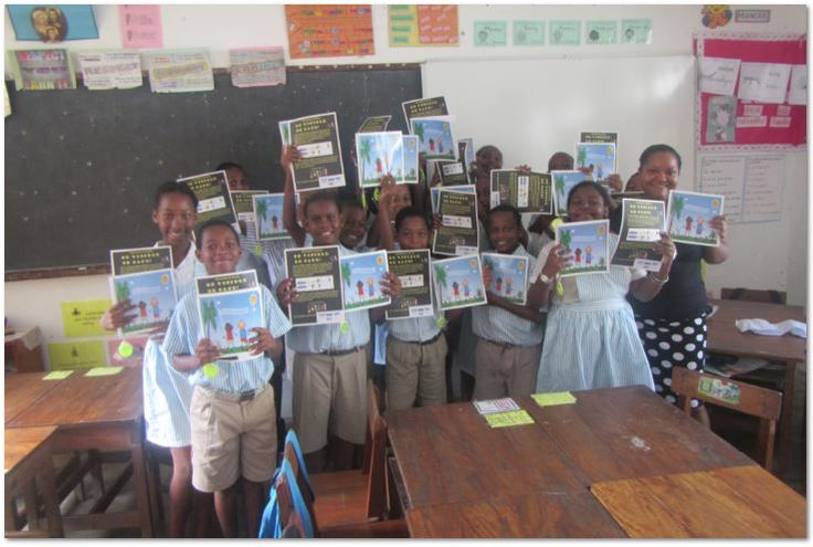"""Playtime Seychelles visited today during Seychelles National Road Safety Week La Retrait Primary School and handed over the book """"Kisisa en reflekter?"""" and a reflector to each one of the students in the school. This donation is affiliated to Playtime Seychelles project Be Visible Be Safe! The donation is sponsored by Barclays Bank Seychelles. Coreflect AB Finland and Playtime Seychelles. The books are printed by a donation from the US Embassy of Americ"""