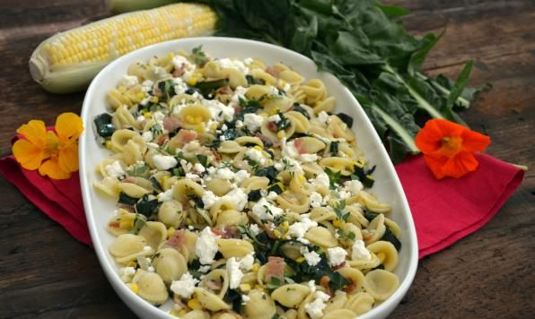 Crispy bits of bacon with sweet corn tossed with mustard greens and your favourite pasta. Top this with a bit of tangy goat cheese and fresh thyme.