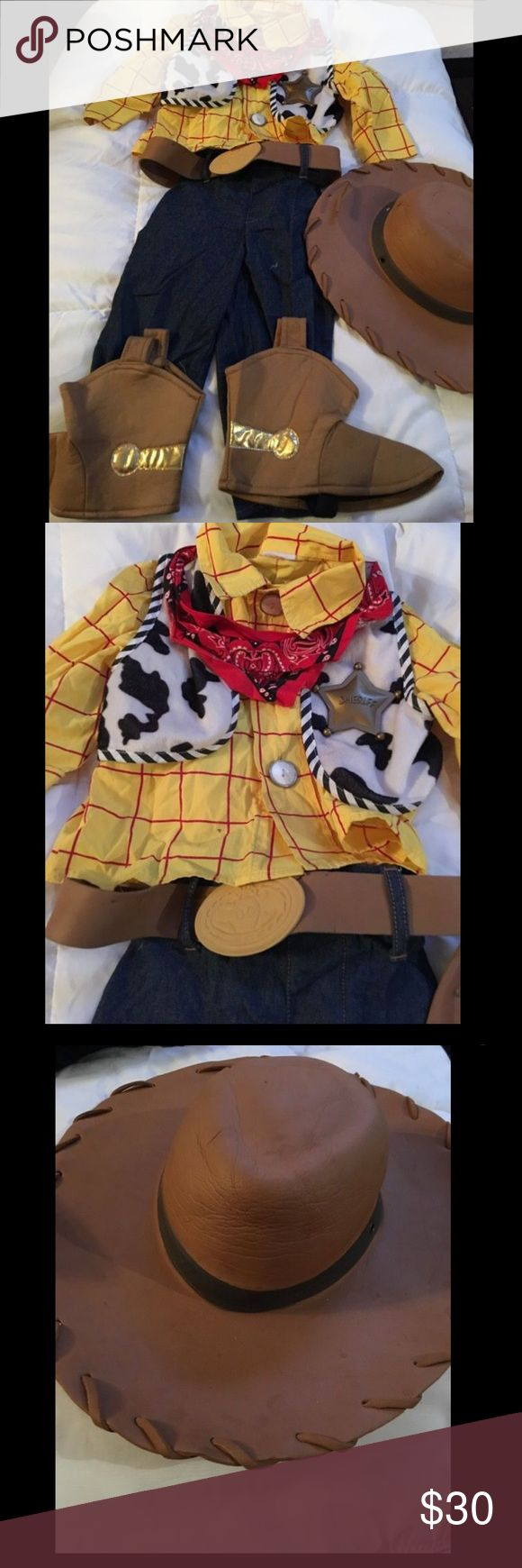 Disney Toy Story WOODY Costume size XXS 2/3 Toddler's Halloween costume from the Disney Store. From the movie Toy Story, here is Andy's toy: Woody. Size XXS (2/3). Includes shirt, vest, sheriff badge, pants, bandana, belt, and a pair of boots (shoe covers). Belt and hat shows some wear, the rest is excellent condition. Disney Costumes Halloween