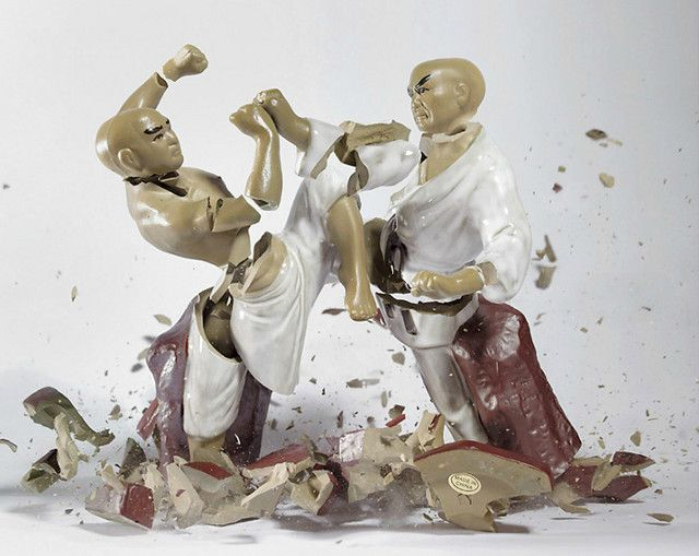 This is from a series of photographs by German artist Martin Klimas. Porcelain figures are dropped and photographed at the moment of impact.