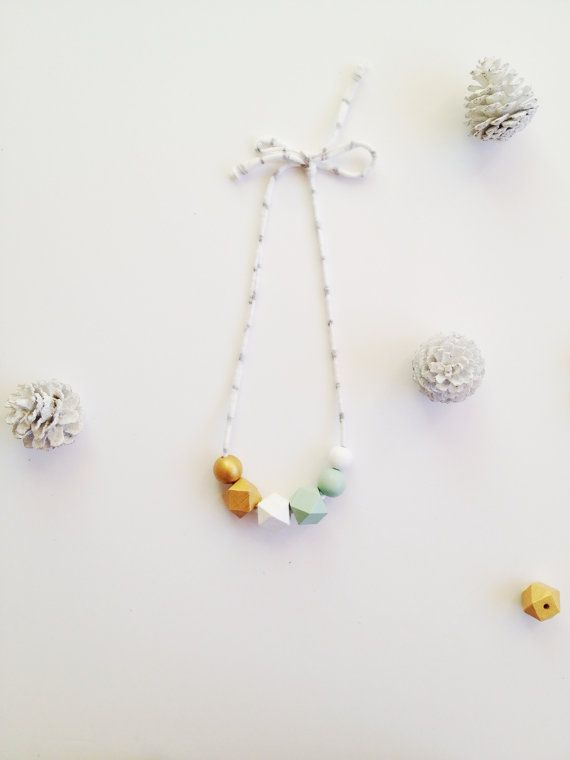 This is a fun, vibrant necklace, perfect for any holiday occasion, made of wooden beads hand painted with 3-5 coats of acrylic paint and finished