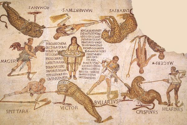 """Venatio is being carried out under the aegis of Diana, goddess of the hunt,shown in a short tunic carrying a stalk of millet, and Dionysus, subduer of animals, who carries a staff with a crescent-shaped head. In the center herald bears a tray with 4 bags of money. The cost of the spectacle is 500 denarii for each of the 4 leopards, but the crowd exhorts him to pay more, which he does, paying 1000 apiece. The shouts of acclamation, """"Magerius (producer),"""" are shown on either side of the panel."""