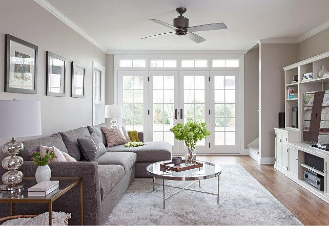 Whole House Paint Color IdeasThis beautiful light-filled living room features oak flooring, Benjamin Moore Simply White paint on the ceiling and Benjamin Moore Revere Pewter paint on the walls, Integrity Wood-Ultrex swinging french doors, and a Minka Aire Strata ceiling fan in Smoked Iron.