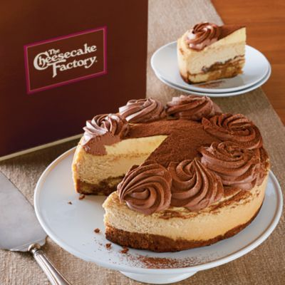 As the exclusive online vendor for The Cheesecake Factory®'s cheese, we here at Harry & David are excited about all the flavors we now get to try. Like the Tiramisu Cheesecake. Inspired by the classic Italian dessert, this exquisite treat combines the fun of ladyfingers and whipped cream with the rich, delightful flavors of mascarpone cheese and coffee liqueur. The origins of Tiramisu aren't certain, but one thing we do know is that this cake is luscious, creamy and delicious.