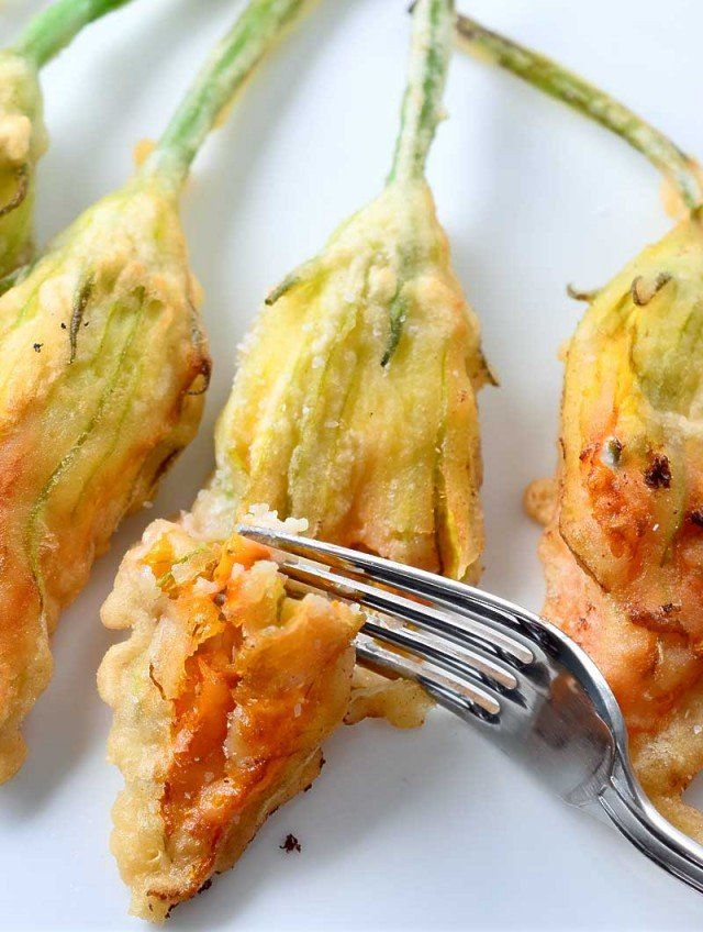 Light, crispy, airy and cheese stuffed, these goat cheese stuffed fried zucchini blossoms are appetizer perfection.