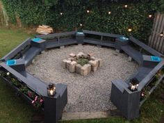 Firepit constructed from Treated Pine Decking. WBP plywood frame sitting on Concrete Blocks. Decorated with flower pots and pebble stone. Beer ice buckets inserted into table tops