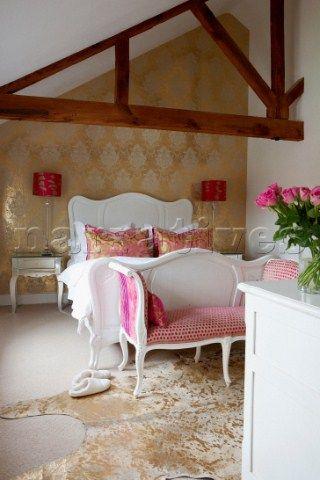 Metallic wallpaper, beams, white walls, vaulted ceiling
