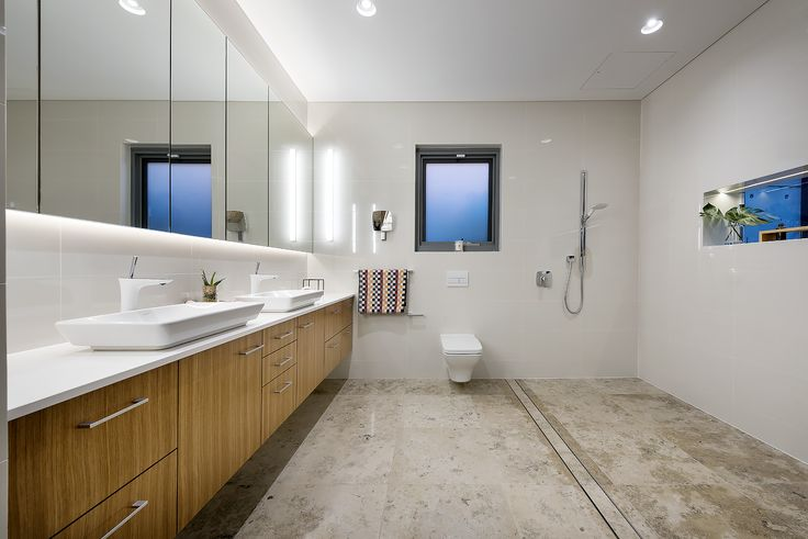 Master Ensuite featuring Jura Blue Stone flooring, timber veneer vanity and open shower. Designer: Greg Davies Architects, Builder: Urbane Projects
