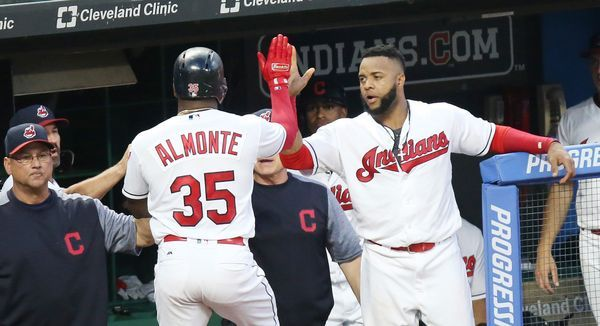 Cleveland Indians first baseman Carlos Santana congratulates Abraham Almonte after he scored in the fifth inning off a hit by Erik Gonzalez against the Toronto Blue Jays, July 21, 2017, at Progressive Field. (John Kuntz, cleveland.com). Indians won 13-3