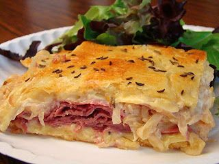 Reuben Crescent Bake: refrigerated crescent roll dough, sliced Swiss cheese, sliced corned beef, sauerkraut, Thousand Island dressing, egg white, and caraway seeds.