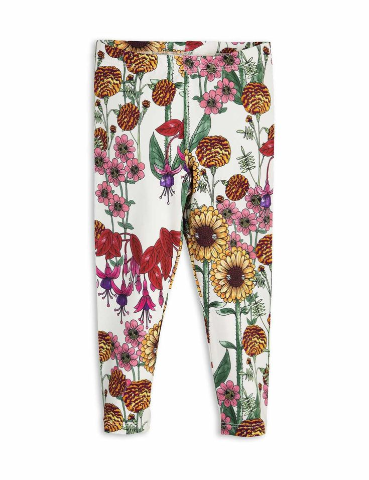 Off-white-colored leggings by Mini Rodini with multi-colored flower print. The leggings have a soft elastic waistband and are made of organic cotton.