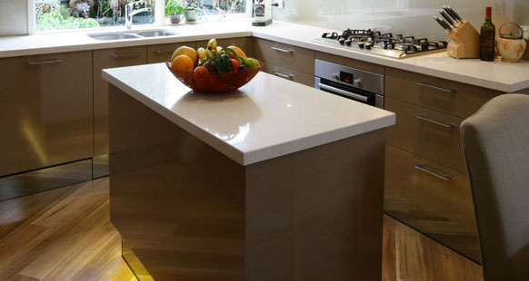 'Ice Snow' Caesarstone benchtop in kitchen renovation with island bench kicker lighting.