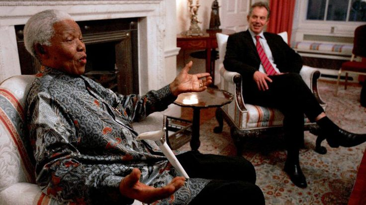 Nelson Mandela with then British Prime Minister Tony Blair at his residence in Downing Street, in February 2005