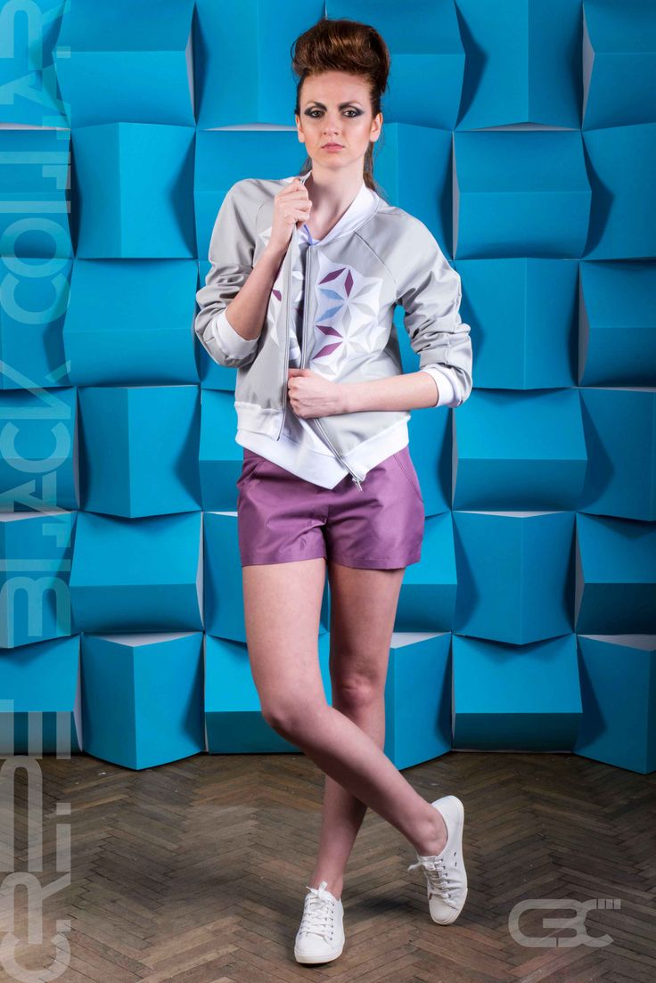 Grey bomber jacket with geometric white, blue and purple flowers. Purple shorts. Order via facebook, pm or e-mail.