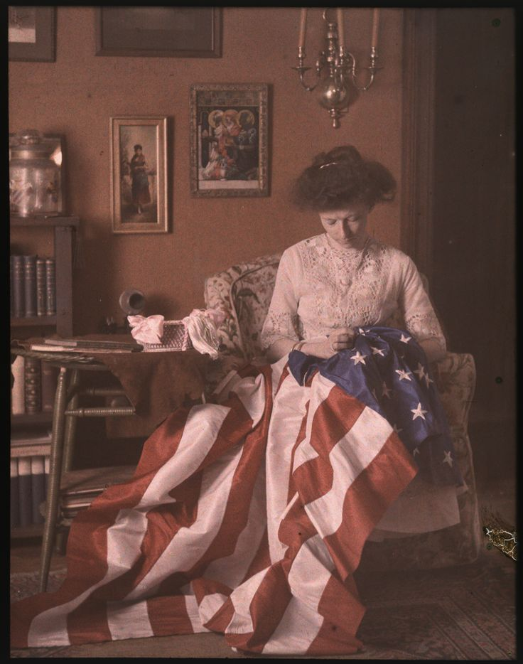 Mrs. Benjamin F. Russell (American, active ca. 1910) Woman sewing American flag, ca. 1910, Autochrome, Gift of 3M Company; ex collection Louis Walton Sipley