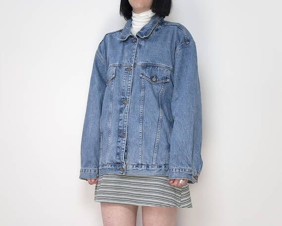 Amazing 90s oversize stone wash denim jacket by Manager Jeans. Has two hidden pockets on the inside of the jacket. Excellent vintage condition.  Brand: Manager Jeans Material: 100% cotton Made in: CANADA Listed Size: 2X (depending on desired fit, this jacket would work great on a size medium to XL)  For best fit, please compare the following measurements to a similar garment of your own:  FLAT  Shoulders: 22 Chest: 26.75 Waist: 26 Hips: 26 Length: 27.5 Sleeve length (from under the arm to…