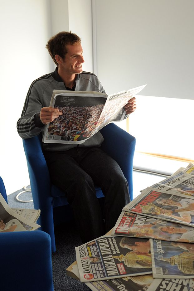Andy Murray with the newspapers the morning after his win