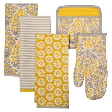 i am obsessed with gray and vintage yellow together...I bought these dish towels at Target yesterday. :-) $9.99