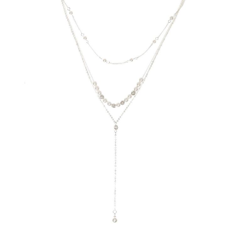 Silver-tone Fireball and White Faux Pearl Y Necklace | Add lengty layers of classic style to your outfit with this trendy necklace. Thin silver chains are embellished with silver-tone fireballs and white faux pearls as a single white faux pearl hangs from a Y-shaped chain. Glam up your look for special occasions.