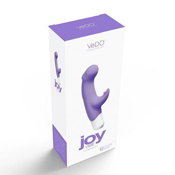 JOY orgasmic orchid dual action g-spot vibrator by Vedo. Joy VIBE is sure to double your pleasure. Designed to stimulate the G-spot with the gently curved head while you electrify your clitoris with the flexible rabbit tickler. This vibe is perfectly paired for a ride you'll never forget. Presented by the sex shop La Cle du Plaisir.