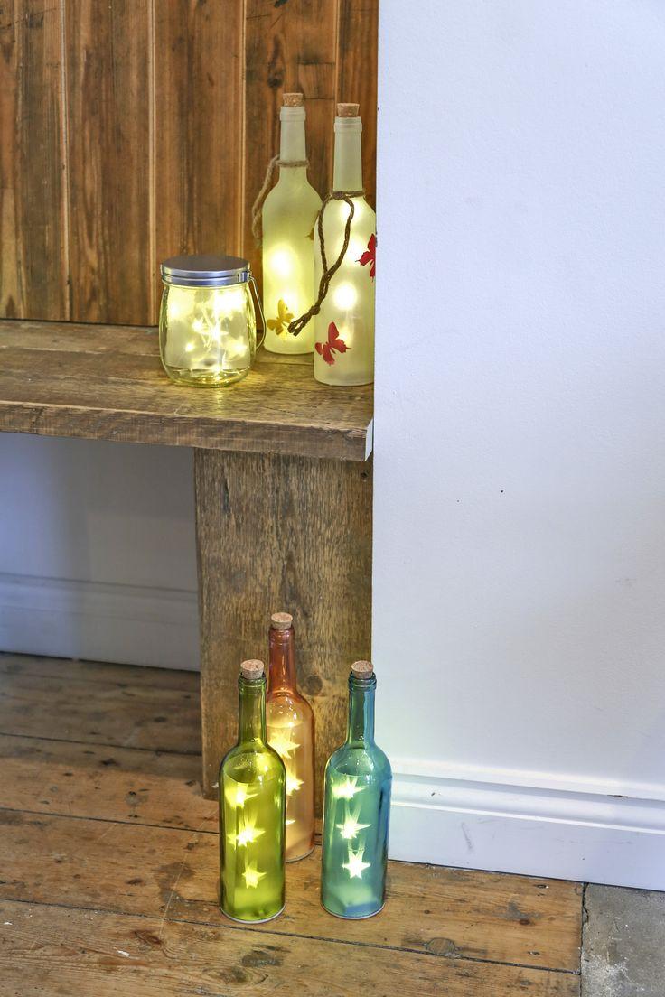 Luces en botella. #led #bottles #botellasdecristal #botellas #cristal #iluminación #hogar #decoración #festivo #party #fiesta #noche #night
