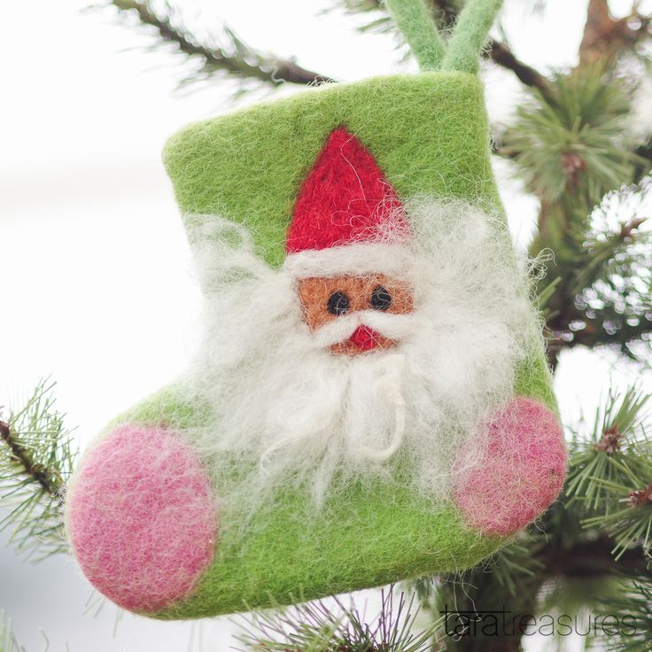 Santa Claus felt stocking. A mini felt stocking to be filled with little goodies. #christmas