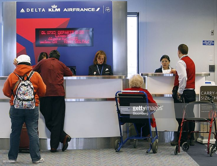 Image result for airport check in desk delta