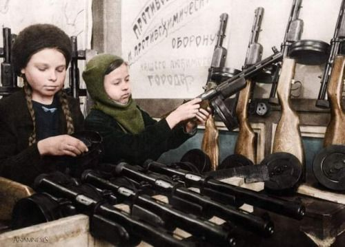 Two young girls assemble submachine guns during the siege of Leningrad, 1943. The siege lasted for 2 years, 4 months, 2 weeks and 5 days and led to the death of up to 1000000 civilians.