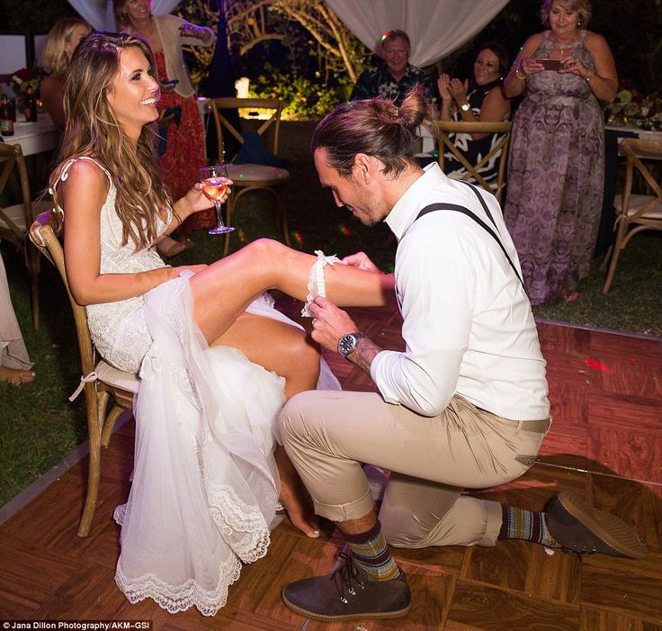 Sly fox: Audrina Patridge had garter slid off her bare leg by new husband Corey Bohan at their wedding reception on Saturday in Hawaii